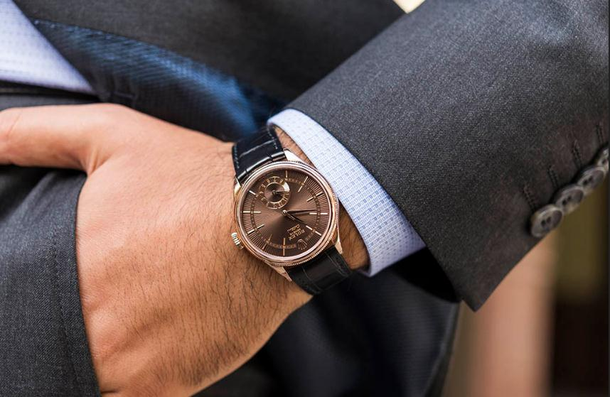 The male copy watches have black leather straps.